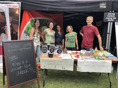 Members of Tyndall behind their stall at Bluedot Festival in Cheshire, UK.